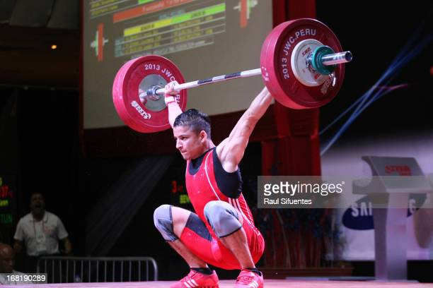 Karem Banhina of Turkey A competes in the Men's 69kg Snatch during day three of the 2013 Junior Weightlifting World Championship at Maria Angola...