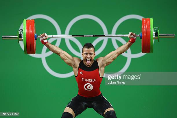 Karem Ben Hnia of Tunisia competes during the Men's 69kg Group A Weightlifting contest on Day 4 of the Rio 2016 Olympic Games at the Riocentro...
