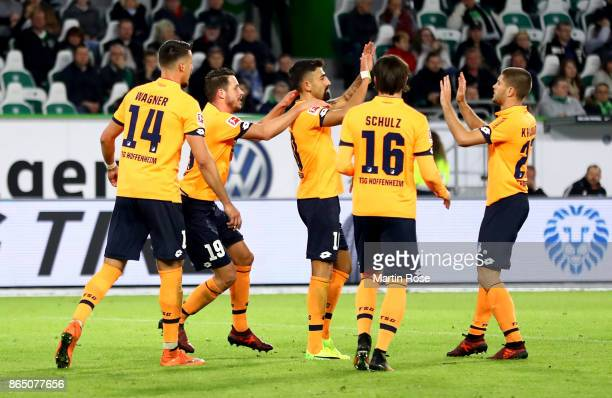Karem Demirbay of Hoffenheim celebrate with his team mates after he scores the opening goal by penalty kick during the Bundesliga match between VfL...