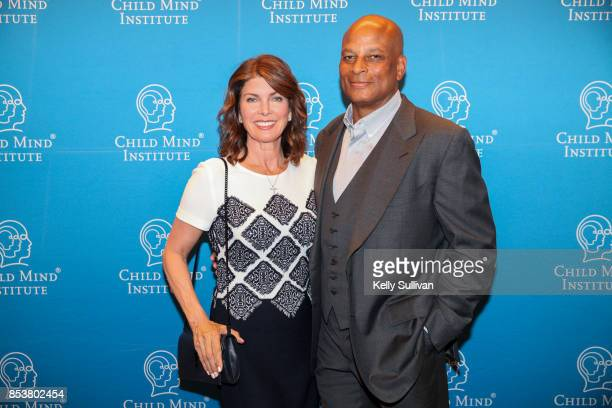 Karen and Ronnie Lott pose for a photo at the Child Mind Institute Fall Luncheon on September 25 2017 in East Palo Alto California