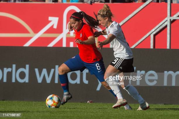 Karen Araya of Chile and Svenja Huth of Germany battle for the ball during the international friendly match between Germany Women and Chile Women at...