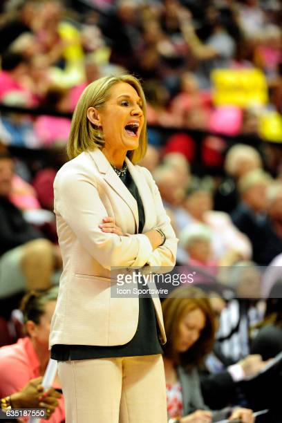 Karen Aston women's head coach Texas Longhorns shouts from the sideline as her team comes back against the Florida State University Seminoles on...