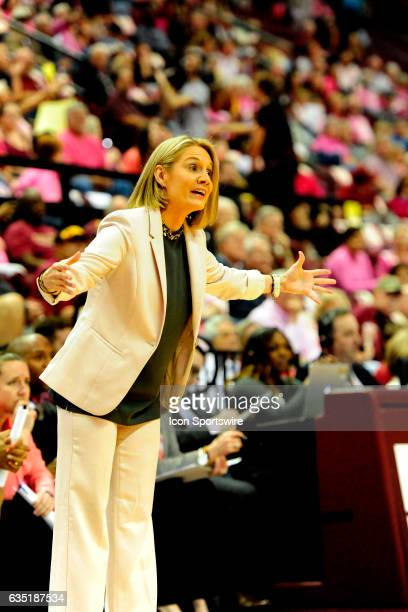 Karen Aston women's head coach Texas Longhorns signals from the sideline as her team comes back against the Florida State University Seminoles on...