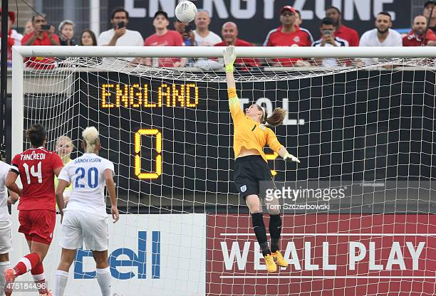Karen Bardsley of England leaps as she watches the ball sail above the net against Canada during their Women's International Friendly match on May 29...