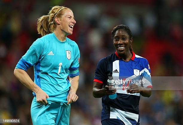 Karen Bardsley of Great Britain and Anita Asante of Great Britain celebrate their team's victory after the Women's Football first round Group E Match...