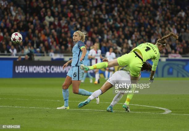 Karen Bardsley of Manchester City runs into Alex Morgan of Olympique Lyon during the UEFA Women's Champions League Semi Final second leg match...