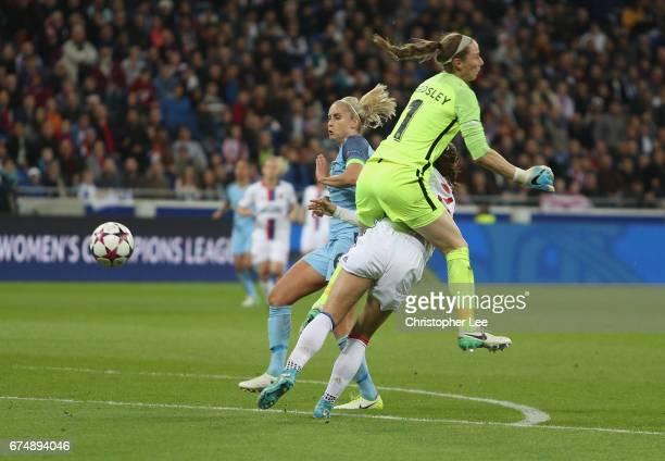 Karen Bardsley of Manchester City runs into Alex Morgan of Olympique Lyon during the UEFA Women's Champions League Semi Final second leg match...