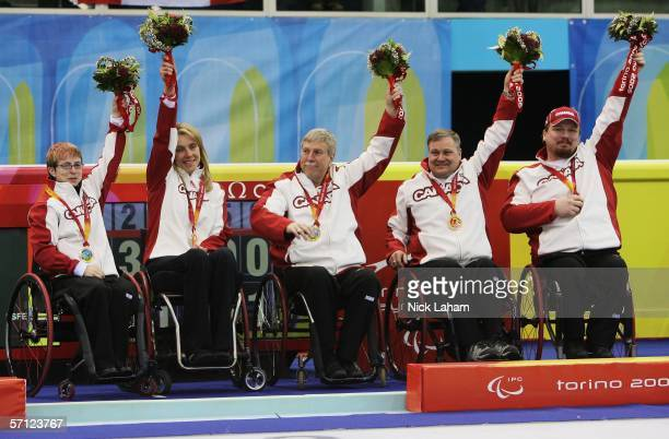 Karen Blachford Sonja Gaudet Gary Cormack Gerry Austgarden and Chris Daw of Canada celebrate winning the Gold Medal after the Wheelchair Curling...