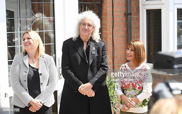 Karen Bradley Brian May and Kashmira Cooke attend the unveiling of an English Heritage Blue Plaque commemorating where Freddie Mercury lived on...