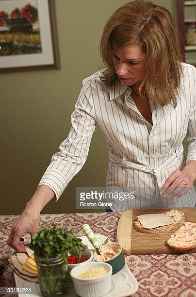 Karen Bradshaw makes panini sandwiches with turkey leftover from Thanksgiving She spreads the bread with a cheese mixture made of several kinds of...