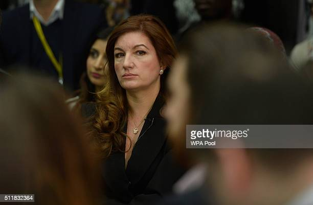 Karen Brady listens as British Prime Minister David Cameron delivers a speech on the European Union to workers and guests at the headquarters of O2...