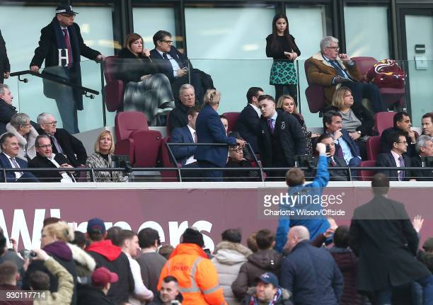 Karen Brady looks down on protesting fans who have gathered on the concourse below during the Premier League match between West Ham United and...