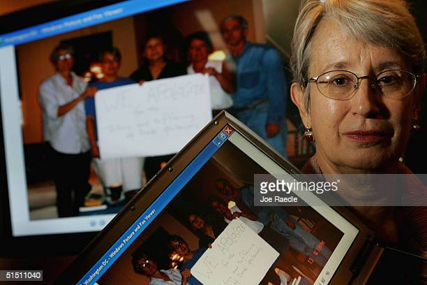 Karen Branan holds a computer displaying the photograph she submitted for The Fellowship of Reconciliation Iraq Photo Project during a news...
