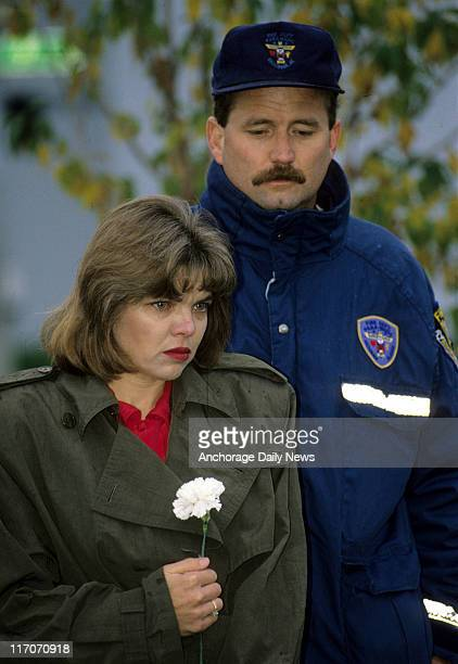 Karen Campbell and fiance Jim Foster hold back tears during a wreath hanging for Bonnie Craig at the 9th G Street Victim's Tree on the Delaney...