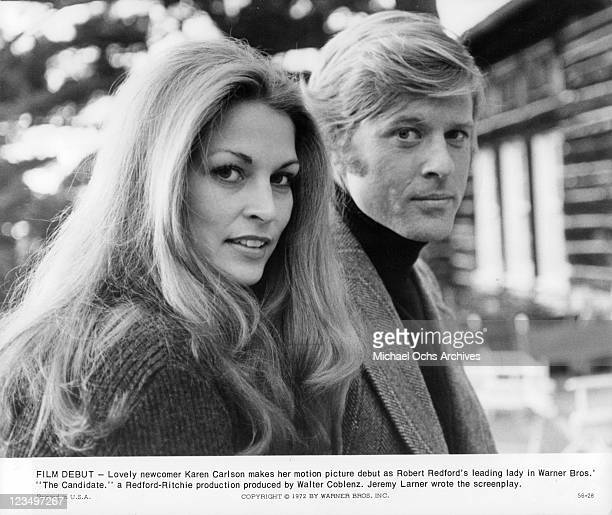 Karen Carlson and Robert Redford smile and look over at camera in a scene from the film 'The Candidate' 1972