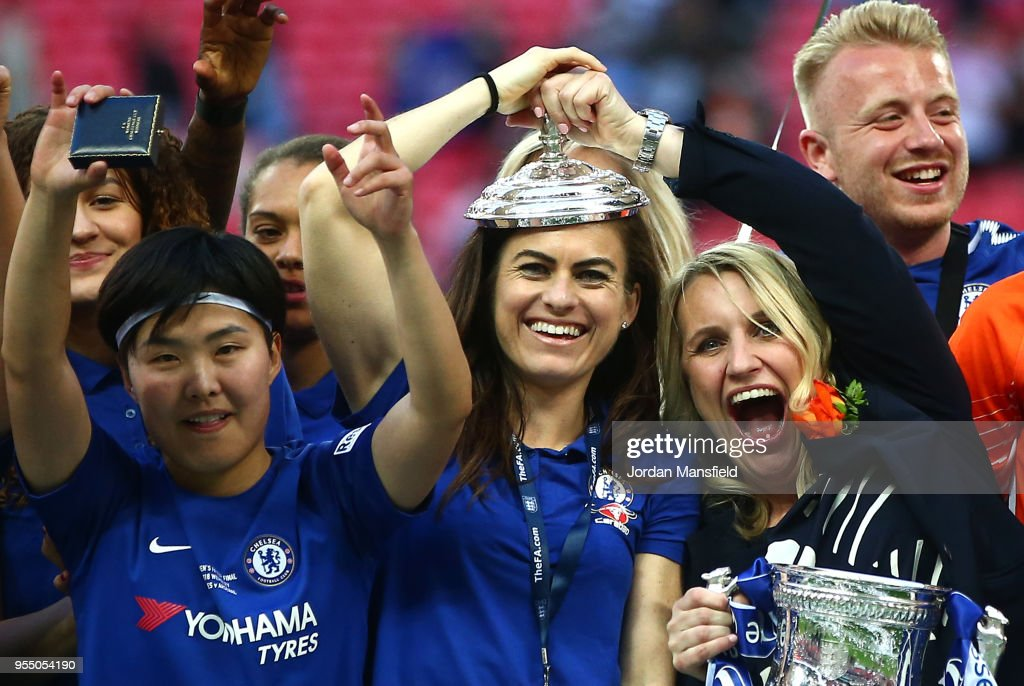 Karen Carney and Chelsea manager, Emma Hayes celebrate with the trophy during the SSE Women's FA Cup Final match between Arsenal Women and Chelsea Ladies at Wembley Stadium on May 5, 2018 in London, England.