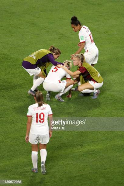 Karen Carney Demi Stokes and Leah Williamson of England console teammate Steph Houghton of England following their team's defeat in the 2019 FIFA...