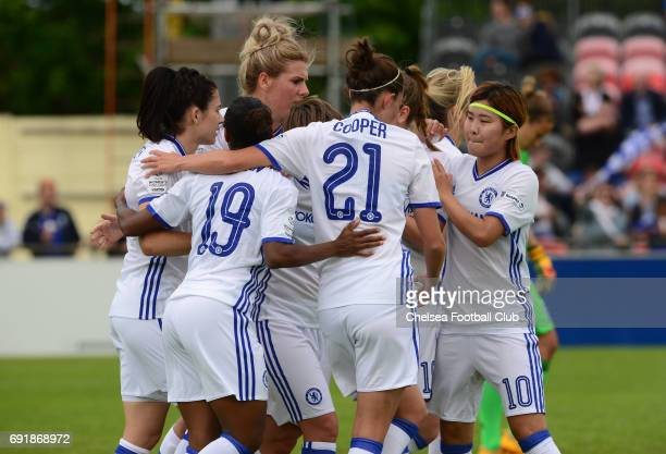 Karen Carney of Chelsea celebrates with team mates after she scores from the penalty spot to make it 10 during the WS1 match between Birmingham City...