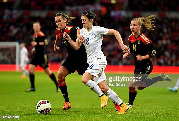 Karen Carney of England and Lena Goessling of Germany compete for the ball during the Women's International Friendly match between England and...