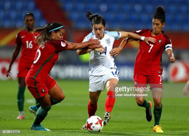 Karen Carney of England holds off pressure from Suzane Pires and Claudio Neto of Portugal during the UEFA Women's Euro 2017 Group D match between...