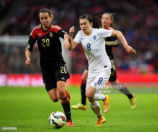 Karen Carney of England is challenged by Lena Goessling of Germany during the Women's International Friendly match between England and Germany at...