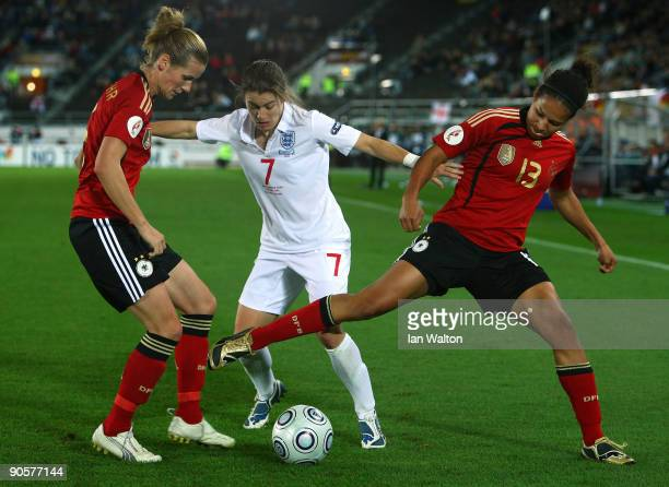 Karen Carney of England tries to tackle Celia Okoyino da Mbabi of Germany during the UEFA Women's Euro 2009 Final match between England and Germany...