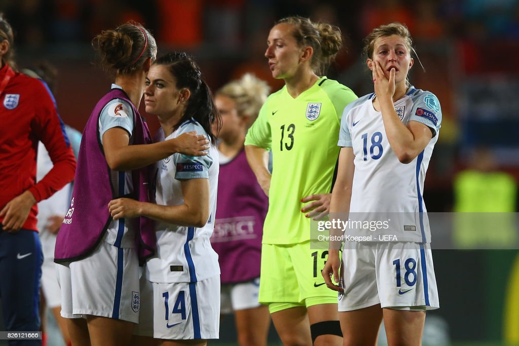 Karen Carney, Siobhan Chamberlain and Ellen White of England look dejected after losing 0-3 the UEFA Women's Euro 2017 Second Semi Final match between Netherlands and England at De Grolsch Veste Stadium on August 3, 2017 in Enschede, Netherlands.