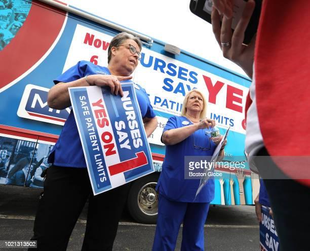 Karen Coughlin left and Donna KellyWilliams president of the Massachusetts Nurses Association chat following a nurses rally near Partners HealthCare...