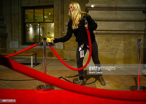 Karen Cruz hooks in the velvet ropes along the red carpet for opening night of the Denver Film Festival on November 4 2015 at the Ellie Caulkins...
