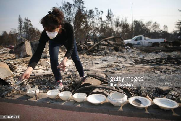 Karen Curzon salvages her grandmother's China set from the remains of her home in the Coffey Park neighborhood on October 15, 2017 in Santa Rosa,...