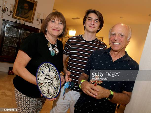Karen Davis who is Jewish and her husband Nick Athanassiadis who is Greek Orthodox with their son Michael She is holding a Seder plate for Passover...