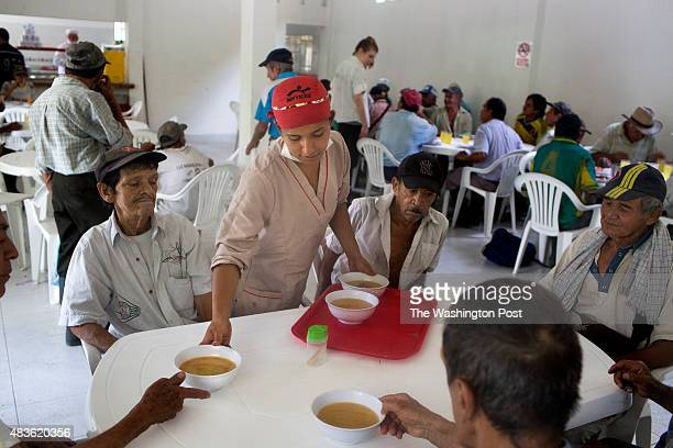 Karen Dicelis serves soup at the community eatery El Mirador de los Abuelos for lunch in the municipality of Muzo department of Boyacá Colombia on...