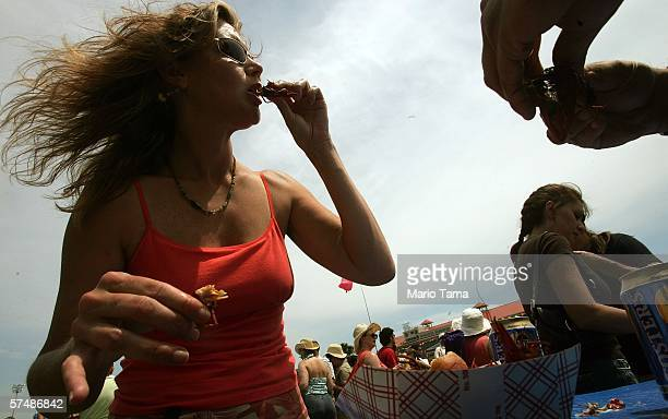 Karen Dunn eats crawfish on the first day of the New Orleans Jazz Heritage Festival April 28 2006 in New Orleans Louisiana This is the first time the...