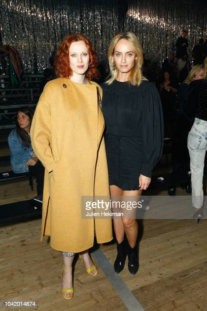 Karen Elson and Amber Valletta attend the Isabel Marant show as part of the Paris Fashion Week Womenswear Spring/Summer 2019 on September 27 2018 in...