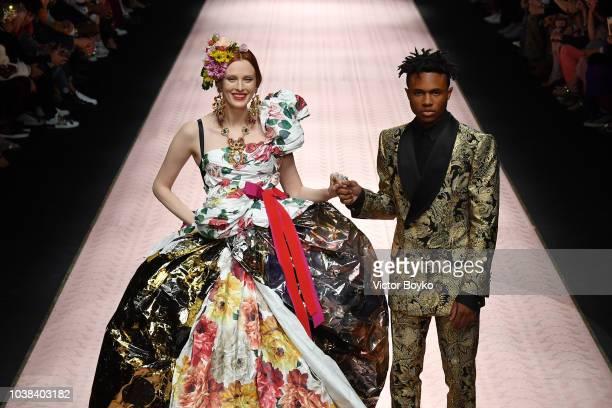 Karen Elson and Kailand Morris walk the runway at the Dolce Gabbana show during Milan Fashion Week Spring/Summer 2019 on September 23 2018 in Milan...