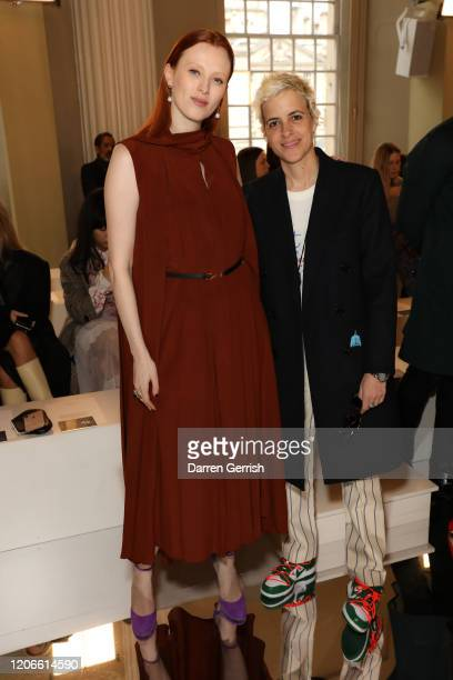 Karen Elson and Samantha Ronson attend the Victoria Beckham show during London Fashion Week February 2020 on February 16 2020 in London England