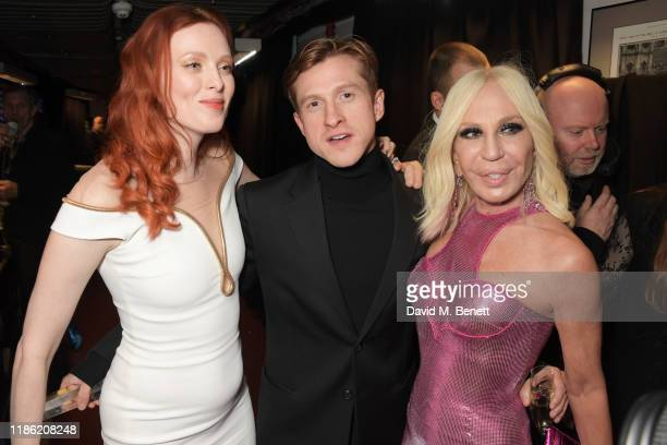 Karen Elson Daniel Lee winner of the Designer of the Year award and Donatella Versace pose backstage stage during The Fashion Awards 2019 held at...