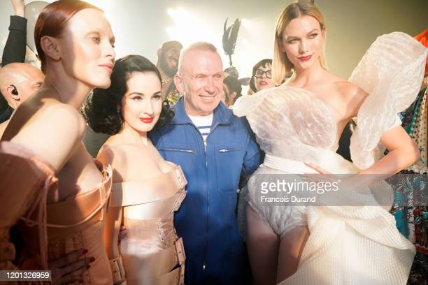 Karen Elson Dita Von Teese JeanPaul Gaultier and Karlie Kloss are seen backstage after walking the runway at the JeanPaul Gaultier 50th Birthday show...