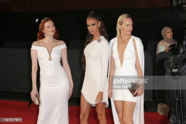 Karen Elson, Joan Smalls and Amber Valletta arrive at The Fashion Awards 2019 held at Royal Albert Hall on December 02, 2019 in London, England.