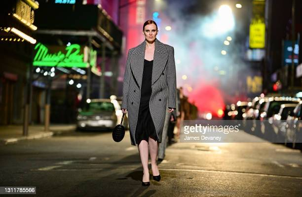 Karen Elson walks along 46th Street during the Michael Kors Fashion Show in Times Square on April 08, 2021 in New York City.