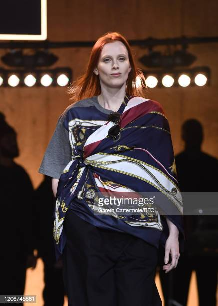 Karen Elson walks the runway at the TommyNow show during London Fashion Week February 2020 at the Tate Modern on February 16 2020 in London England