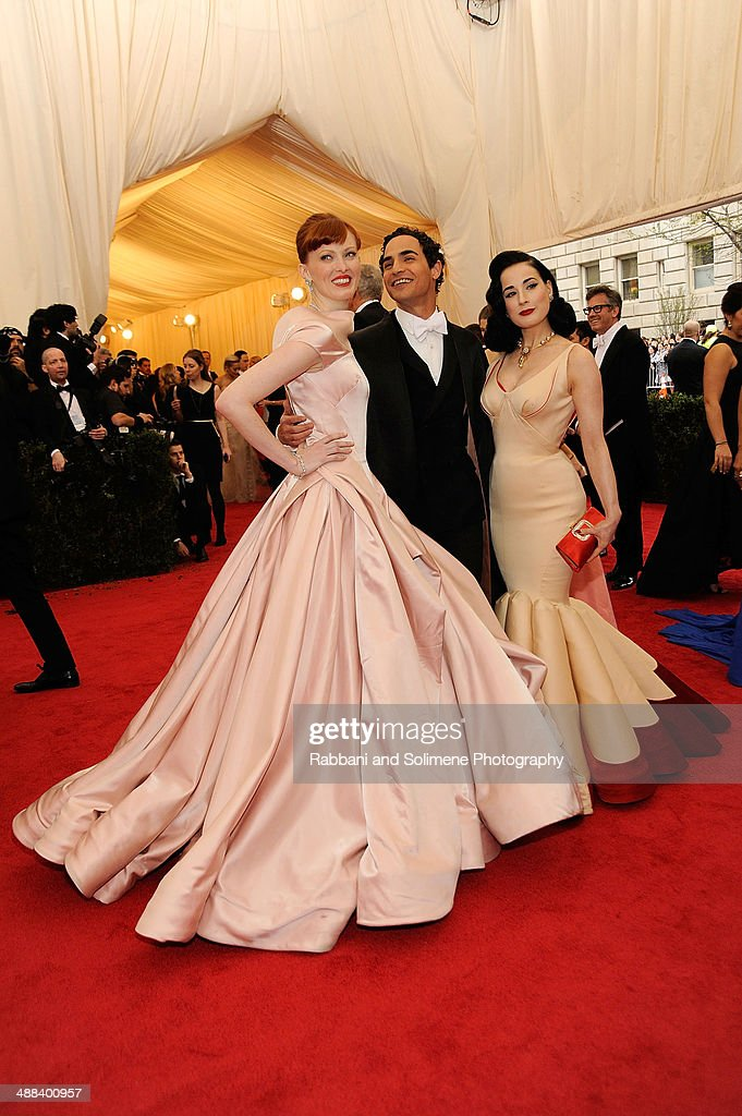 Karen Elson, Zac Posen, Dita Von Teese attends the 'Charles James: Beyond Fashion' Costume Institute Gala at the Metropolitan Museum of Art on May 5, 2014 in New York City.