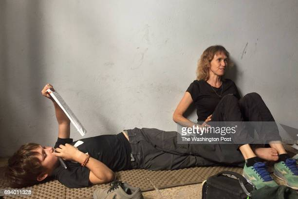Karen Eubank sits with her 11yearold son Peter Eubank who studies math in a room above a medic station in western Mosul where his family are...