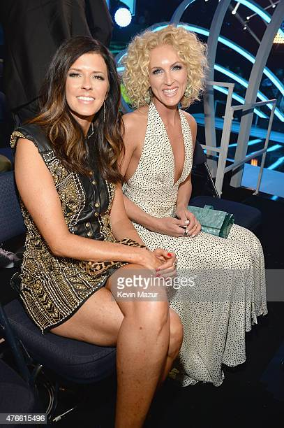 Karen Fairchild and Kimberly Schlapman attend the 2015 CMT Music awards at the Bridgestone Arena on June 10 2015 in Nashville Tennessee