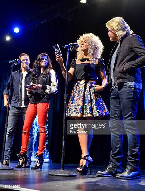 Karen Fairchild Kimberly Schlapman Jimi Westbrook and Phillip Sweet speak during the 48th Annual CMA Awards Nominees Announcement at Best Buy Theater...