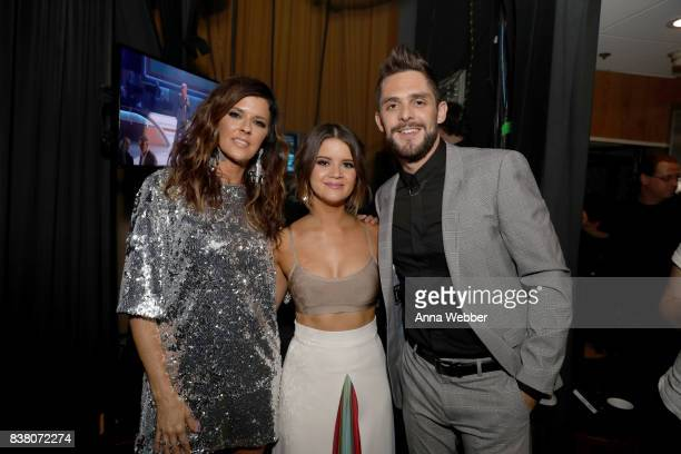 Karen Fairchild Maren Morris and Thomas Rhett pose for a photo backstage during the 11th Annual ACM Honors at the Ryman Auditorium on August 23 2017...