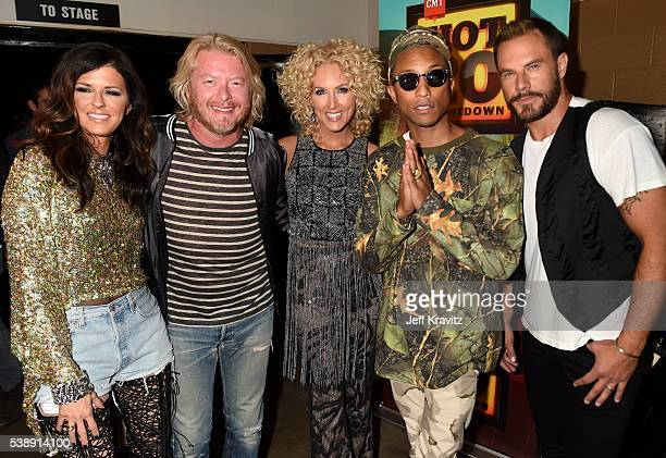 Karen Fairchild Phillip Sweet Kimberly Schlapman Pharrell Williams and Jimi Westbrook attend the 2016 CMT Music awards at the Bridgestone Arena on...
