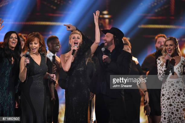 Karen Fairchild Reba McEntire Faith Hill Garth Brooks and Kelsea Ballerini perform onstage at the 51st annual CMA Awards at the Bridgestone Arena on...