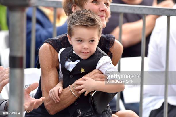 Karen Fisher and Isaiah Michael Fisher attend the ceremony honoring Carrie Underwood with star on the Hollywood Walk of Fame on September 20 2018 in...