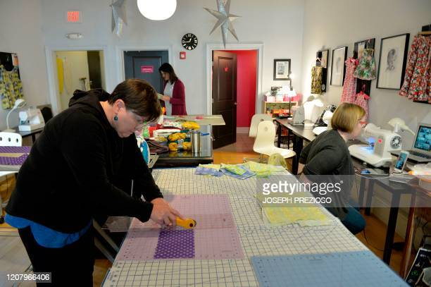 Karen Foley cuts up fabric as part of the first step in creating masks at Stitch House in Dorchester Massachusetts on March 22 2020 With a huge...